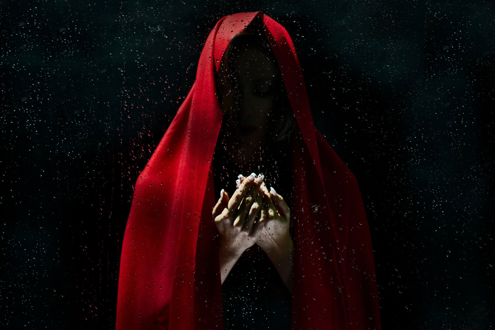 A woman with a red cloak draped over her head. A tribute to mrBallen.